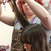 1-19-14<br /> Camilla Chesshir gets hair cut to donate it to make a wig for a co-worker who has cancer<br /> Charlien Haworth cuts the hair of Camilla Chesshir at Beauty Buzz on Sunday. Chesshir donated her locks to make a wig for her co-worker who has cancer.<br /> KT photo | Kelly Lafferty