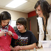 1-16-14<br /> Lego Days at Central Middle School<br /> IUK student Mary Katheryn Dudley (right) watches and helps as third grader Sedalia Herrera and fifth grader Maddisyn Jones put together a car using Legos during lego days at Central Middle School.<br /> KT photo | Kelly Lafferty