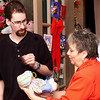 12/25/00<br /> Favors Christmas<br /> Frances Robinson helps Chris McMinn pick out a free gift for the Favors Christmas. This is Frances's 2nd year of volunteering. Chris's family was out of town<br /> Kt photo by Bruce Pyke