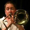 "7-18-12<br /> John Huntoon plays a solo on the trombone during ""Fandango,"" a piece by Joseph Turrin, during the Kokomo Park Band concert at Kokomo High School on Wednesday night.<br /> KT photo 