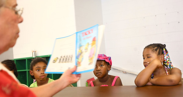7-22-12<br /> Marilyn Skinner, from the early learning education center at IUK, reading to kids during the summer reading activites at Carver Community Center. They are Zaire Garrett, Neria Coleman and Emoni Burton.<br /> KT photo | Tim Bath