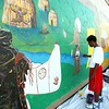 7-17-12<br /> Mural being painted on the side of the downtown bus station by volunteers from the Kokomo Art Association and kids from the YMCA's ARISE(Attitude Respect Initiative Service Education) program. Jeremiah McCauley, 16 painting the Indians shield.<br /> KT photo | Tim Bath