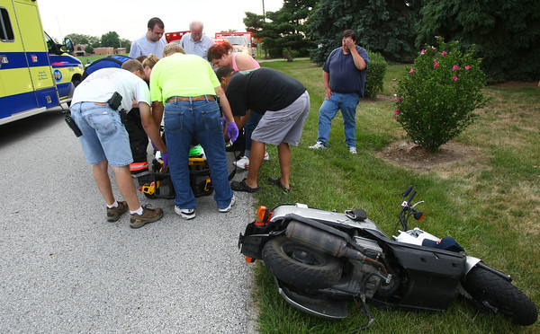7-22-12<br /> St. Joseph Medics and Galveston Volunteer firefighters load Scott Bell onto a stretcher. He was found face down at 3858 West 350 North about 6 p.m. says witnesses that came up on the scene after the accident occured. They said he was face down and breathing shallow till they turned his head enough to get air in. He was taken to St. Joseph Hospital.<br /> KT photo | Tim Bath