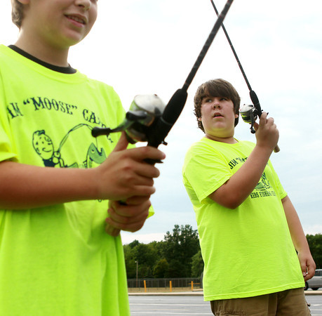 7-17-12<br /> Kids fishing clinic<br /> Tristan Churchill, 12, (left) and Joshua Archer, 12, practice casting in the parking lot of Kokomo High School during the Kids Fishing Clinic on Tuesday.<br /> KT photo | Kelly Lafferty