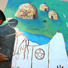 7-17-12<br /> Mural being painted on the side of the downtown bus station by volunteers from the Kokomo Art Association and kids from the YMCA's ARISE(Attitude Respect Initiative Service Education) program. Joseph McCauley, 12 painting an Indian next to a canoe.<br /> KT photo | Tim Bath