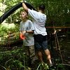 7-25-12<br /> Aidan Frazier helps his dad Chris Frazier rope off the course in preparation for the Mud Battle at Oakbrook Park on Saturday. The deadline to register for the race is Friday at 4 p.m.<br /> KT Photo | Kelly Lafferty