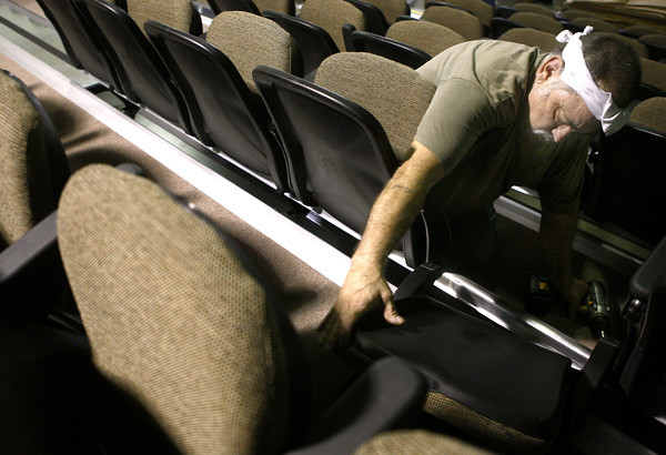 7-26-12<br /> Jerry Vines installs the seating in what will be the auditorium for the Wallace School of Integrated Arts.<br /> KT photo | Tim Bath