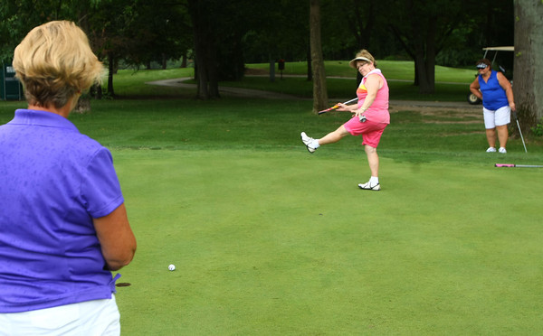 7-26-12<br /> Chippendale Ladies Invitational at Chippendale Golf Course.<br /> Marty Obermeyer watches as Betty Underly tries to coax a put into the hole on the 6th green. Cindy Miller is also watching from behind.<br /> KT photo | Tim Bath