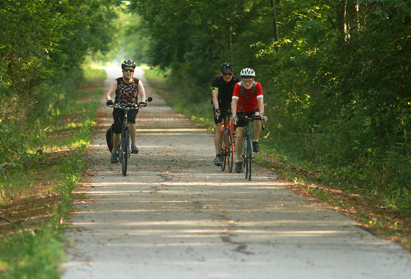 7-7-12<br /> People bike and walk down the Nickel Plate trail<br /> Wishart Bell, Mary Bell, and John Nafziger bike together on Nickel Plate Trail on Saturday morning.<br /> KT photo | Kelly Lafferty