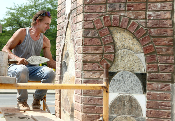 7-5-12<br /> Anderson brothers masonry for a convenience store<br /> Marc Anderson measures and lays down brick and cut stone for the new convenience store on Sycamore he and his brother John are working on.<br /> KT photo   Kelly Lafferty