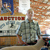 7-12-12<br /> 4H auction at Howard County Fair<br /> Dakota Spencer stands with his sheep as auctioneer Mike Clair auctions it off in the show arena at the Howard County fair on Thursday.<br /> KT photo | Kelly Lafferty