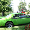 7-21-12<br /> Gary Burns lost control of his green Dodge Challenger crashing into a house at 3723 South Park Road on Sunday morning. He was traveling northbound when he ran off the road to the east, corrected and stopped when he crashed into the house owned by the Delos Hudson(455-0508) family. Gary takes a look at the car about a half hour after it happened.<br /> KT photo | Tim Bath