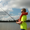 7-28-12<br /> Fishing Clinic at Kokomo Reservoir Park<br /> 10-year-old Ian Hancock fishes during the last day of the kids fishing clinic at Kokomo Reservoir Park.<br /> KT photo | Kelly Lafferty