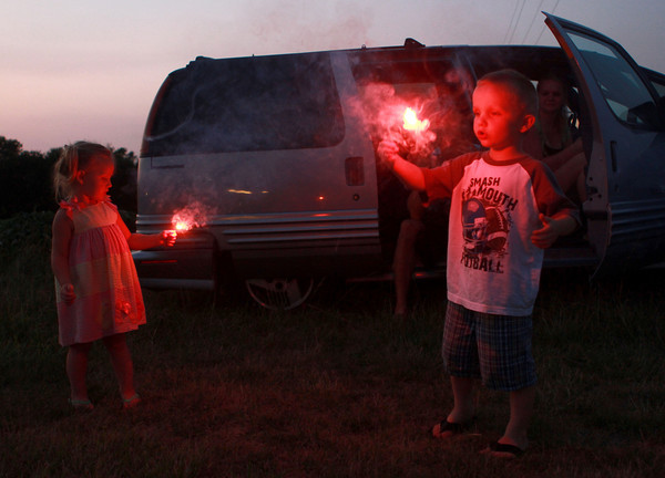 7-4-12  <br /> Fourth of July at Fairgrounds<br /> Contessa Mackey, 2, and Vade Sullivan, 5, play with sparklers at the Howard County fairgrounds on Wednesday.<br /> KT photo | Kelly Lafferty