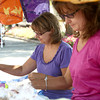 7-21-12<br /> Makers Art Market<br /> Sisters Brenda Whited (left) and Debbie McKee work at their booth called 2 Sisters Keeping you in Stitches, at the Makers Arts Market on Saturday morning.<br /> KT photo | Kelly Lafferty