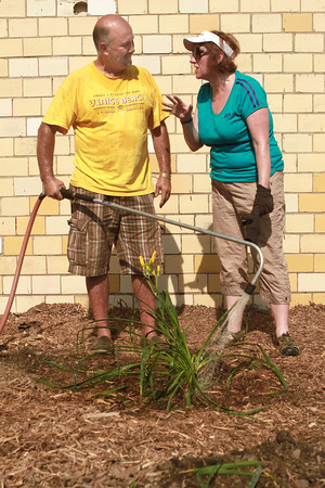 7-7-12<br /> A Scottish Youth Group partners with Grace United Methodist Church to beautify the Industrial Heritage Trail along Main and Markland.<br /> Kevin Summers talks with Mairi Cosgrove on Saturday morning at the Industrial Heritage Trail.<br /> KT photo | Kelly Lafferty