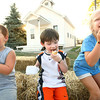 7-11-12<br /> HC Fair rides and food<br /> Hudson Hamilton, 4, Alijah Alexander, 4, and Elle Hamilton, 5, eating ice cream in the Pioneer Village.<br /> KT photo | Tim Bath