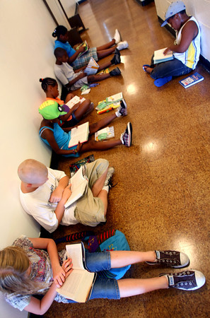 7-22-12<br /> The older kids sit in the hallway after visiting the Kokomo Howard County Public Library's busmobile during the summer reading activites at Carver Community Center.<br /> KT photo | Tim Bath