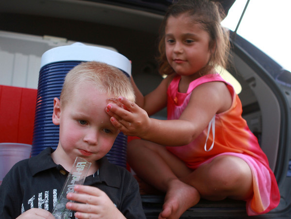 7-4-12  <br /> Fourth of July at Fairgrounds<br /> Isabel Rodriguez puts a piece of ice on Braiden Vandevender to keep him cool as they wait for the fireworks show to begin.<br /> KT photo | Kelly Lafferty