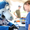 7-18-12<br /> Books for Youth<br /> Blue autographs a jersey for 8-year-old Maddison Parks during the kickoff for the Books for Youth Campaign.<br /> KT photo | Kelly Lafferty