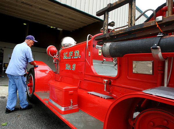 7-23-12<br /> Retired Kokomo Firefighter Mike Calhoun cleans up the 1915 Ahrens Fox Model K-2 serial number 608 that was retired from service in 1953 from Kokomo Fire Department.<br /> KT photo | Tim Bath
