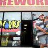 7-2-12<br /> Firework buying in Kokomo<br /> Jeremy Kennedy walks out of USA Fireworks with a stack of fireworks in his arms. Kennedy plans on setting off his fireworks in Miami County for the Fourth of July.<br /> KT photo | Kelly Lafferty