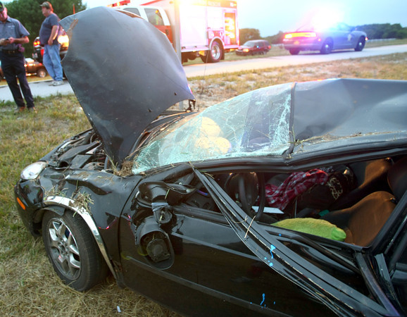 7-19-12<br /> Galveston Firefighters and Howard County Deputies investigate a rollover accident on Davis Road and US35 at shortly after 6 a.m. Thursday.<br /> KT photo | Tim Bath