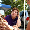 7-21-12<br /> Makers Art Market<br /> Becky Moore (left) looks over the basket as Kellie Cloutier reads over the pattern for it at the Makers Arts Market on Saturday morning.<br /> KT photo | Kelly Lafferty