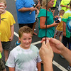 7-17-12<br /> Kids fishing clinic<br /> Micah Kling, (center) 7, watches as line is put on his fishing pole at the 29th annual Kids Fishing Clinic on Tuesday.<br /> KT photo | Kelly Lafferty
