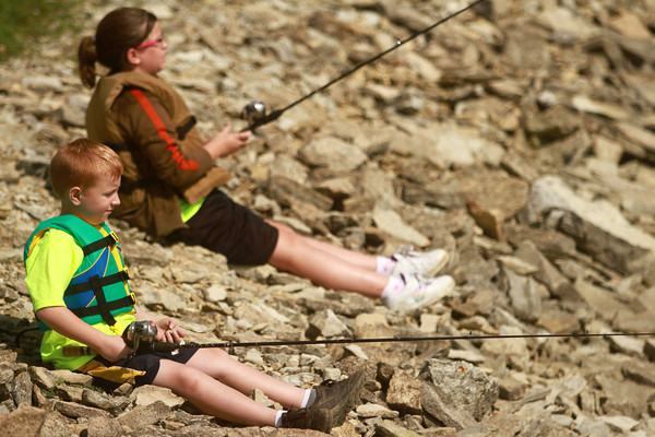 7-28-12<br /> Fishing Clinic at Kokomo Reservoir Park<br /> Jeffrey White, 6, and his sister Delaney White, 10, sit on the rocks next to eachother and fish at Kokomo Reservoir Park on Saturday morning during the kids fishing clinic.<br /> KT photo   Kelly Lafferty