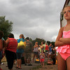 7-19-12<br /> Duck Derby<br /> 9-year-old Amelia Trischman waits at Kokomo Beach for the bad weather to pass so she can watch the Duck Derby. The race was postponed an hour due to lightning.<br /> KT photo | Kelly Lafferty