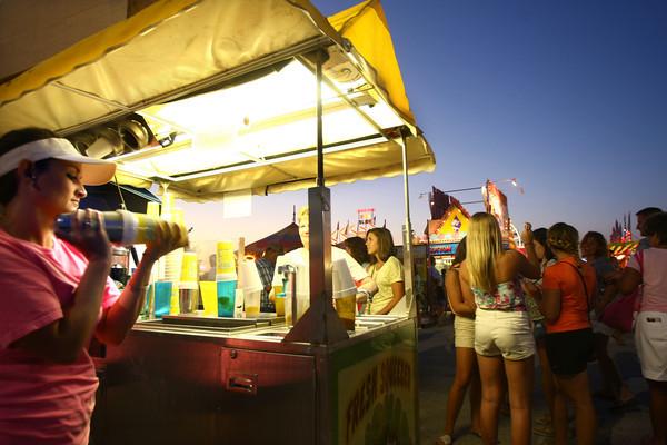 7-11-12<br /> HC Fair rides and food<br /> Kasey Bertram shaking a lemon shake-up.<br /> KT photo   Tim Bath