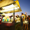 7-11-12<br /> HC Fair rides and food<br /> Kasey Bertram shaking a lemon shake-up.<br /> KT photo | Tim Bath