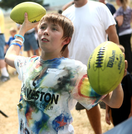7-18-12<br /> Books for Youth<br /> Nolan Helvie, 13, throws footballs into an inflatable game  setup at Haynes International during the kickoff for the Books for Youth Campaign.<br /> KT photo | Kelly Lafferty