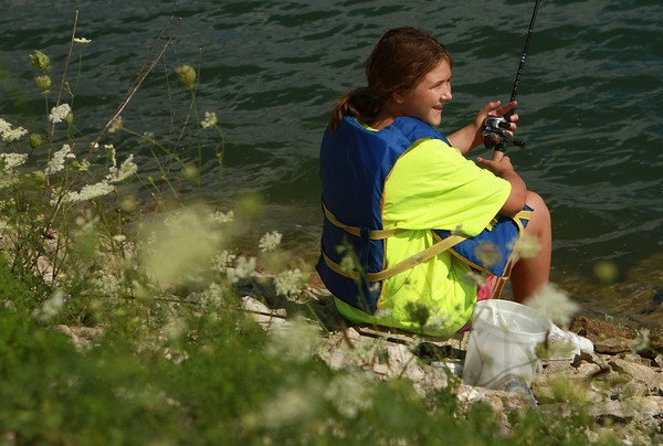 7-28-12<br /> Fishing Clinic at Kokomo Reservoir Park<br /> Christina Smith, 11, fishes at Kokomo Reservoir Park during the final day of the kids fishing clinic on Saturday morning.<br /> KT photo | Kelly Lafferty