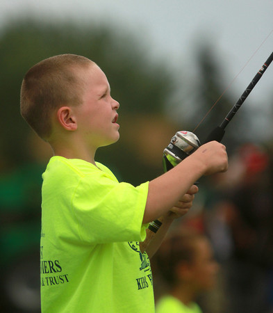 7-17-12<br /> Kids fishing clinic<br /> 6-year-old Kody Underwood reels in his line while he practices casting at the Kokomo High School parking lot during the Kids Fishing Clinic on Tuesday.<br /> KT photo | Kelly Lafferty
