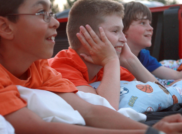 7-4-12  <br /> Fourth of July at Fairgrounds<br /> From left, Adam Farouki, 11, Nick Jozwiak, 11, and Carson Stout, 12, wait in the bed of a truck for the fireworks show to start.<br /> KT photo   Kelly Lafferty