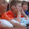 7-4-12  <br /> Fourth of July at Fairgrounds<br /> From left, Adam Farouki, 11, Nick Jozwiak, 11, and Carson Stout, 12, wait in the bed of a truck for the fireworks show to start.<br /> KT photo | Kelly Lafferty