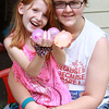 7-5-13<br /> Out and about Columbus Blvd.<br /> Skyla Smith, 7, shows off her waterballoons as she sits on the lap of her 17-year-old sister, Kara Pierce. Smith was unsure of who the target of the waterballoons would be at the time.<br /> KT photo | Kelly Lafferty