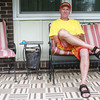 """7-5-13<br /> Out and about Columbus Blvd.<br /> Rob England sits on the porch of his stepfather's home on Columbus Blvd. England says he will enjoy the summer by biking trails in the parks. """"It gives me something to do and keeps me healthy, hopefully,"""" he said.<br /> KT photo   Kelly Lafferty"""