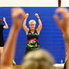 7-2-13<br /> Insanity Workout at YMCA<br /> Lisa Hemmeger (center) follows the instructor during the Insanity workout at the YMCA.<br /> KT photo   Kelly Lafferty