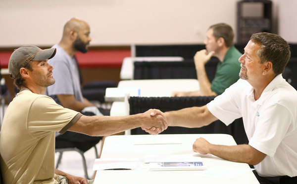 7-22-14 Dan Beard of Duke Energy shakes the hand of Dave Myers, a prospective employee during the Duke Energy job fair. Kelly Lafferty | Kokomo Tribune