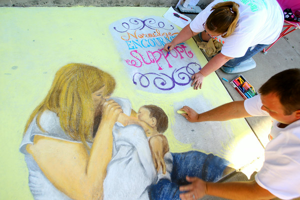 6-6-14   --- Chalk the Block in conjunction with First Friday was a fundraiser for Fair Queen Mollee Mygrant.  Sunny McClurg and Maci McClurg work on their sidewalk art. --<br />   Tim Bath | Kokomo Tribune
