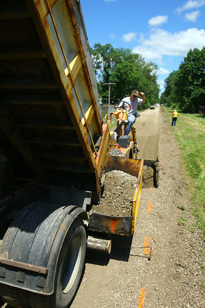 7-3-14   --- City of Kokomo Street Department is putting down a bed of crushed stone where pavement will go on the northern section of the Bike path just north of Morgan Street.  --<br />   Tim Bath | Kokomo Tribune