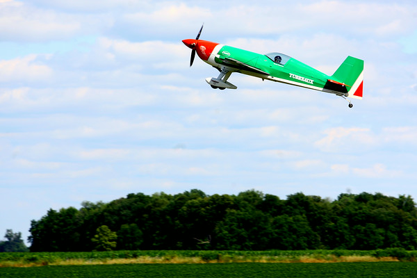 7-24-14 <br /> Airshow practice at Kokomo Municipal Airport in preparation for Saturday's free airshow. Kevin Coleman practicing his performance moves.<br /> Tim Bath | Kokomo Tribune