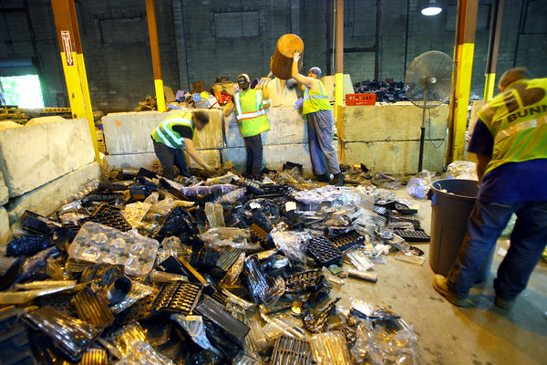 7-3-14   --- Kokomo Recycle at 1701 North Market Street current operations with expansion coming so they can accomadate City of Kokomo curbside program.  Adam Croushore, Aaron Sunday, Adam Slaughter and Scott Hood sort plastics a the center.  --<br />   Tim Bath | Kokomo Tribune