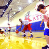 7-23-14 <br /> KHS boys basketball coach Matt Moore holding a basketball clinic for kids in grade 1-8.Jack Sullivan dribbling during one of the drills.<br /> Tim Bath | Kokomo Tribune