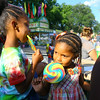 7-3-14   --- Isis White, 7 and sister Imerika White, 3, enjoying the giant suckers at Haynes Apperson Festival.  --<br />   Tim Bath | Kokomo Tribune