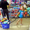 7-25-14 <br /> Grand Opening of Five Below in the Markland Plaza. Kelcee Fowler, 8, pulling a tub of bargains through the store.<br /> Tim Bath | Kokomo Tribune