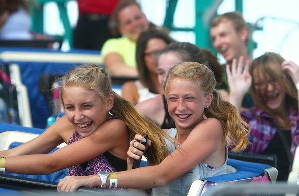 7-10-14<br /> Fair--Thursday<br /> 13-year-olds Natalie Nicholson and Emma Marley laugh as they ride the Himalaya at the Howard County 4H Fair on Thursday.<br /> Kelly Lafferty | Kokomo Tribune